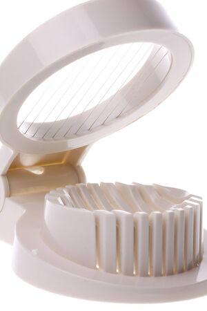 slicer: Isolated image of an egg slicer. Stock Photo