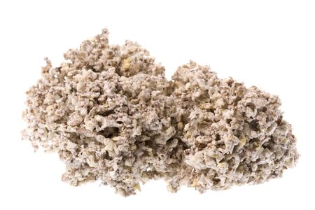 technically: Isolated macro image of raw rubber crumbs that will eventually be oven dried to produce technically specified rubber commodity grades.