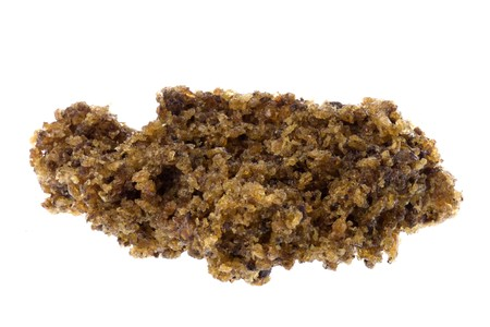 technically: Isolated macro image of oven dried raw rubber crumbs that will eventually be used to produce technically specified rubber commodity grades.
