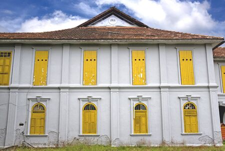forgotten: Image of an abandoned old house, now used as a birdhouse. Holes in the windows allow sawllows in to nest. The nest is then collected and processed into the well known Asian Bird Nest Soup, a delicacy in South East Asia.