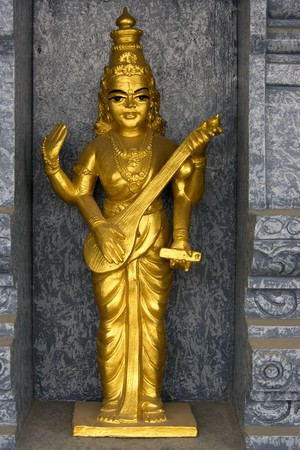 Image of a golden statue located at a Hindu temple in Malaysia. Stock Photo - 4127554