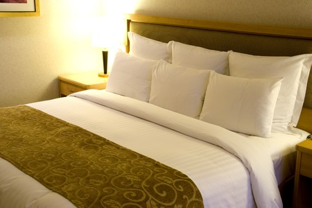 hotel suite: Image of a comfortable looking bed.