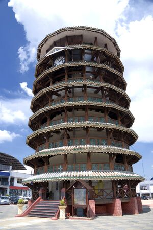 meant: The leaning wooden tower of Teluk Intan, Malaysia. This old tower was meant to hold water at the top for residents of Teluk Intan, which used to be a small town in Malaysia. Like the Leaning Tower of Pisa, it is also leaning. Stock Photo