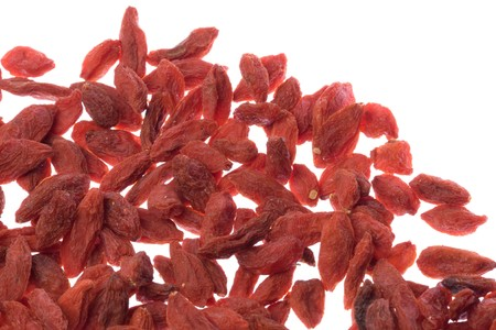 lycii: Isolated macro image of Chinese Wolfberries, a herb commonly known as Kei Chi in Chinese (Fructus Lycii).