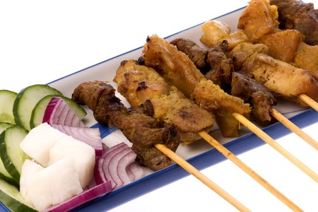 Image of a Malaysian delicacy commonly known as Satay (bamboo stick skewered barbequed meat). Stock Photo