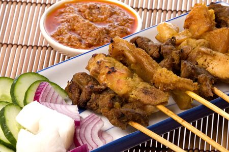 satay sauce: Image of a Malaysian delicacy commonly known as Satay (bamboo stick skewered barbequed meat). Stock Photo