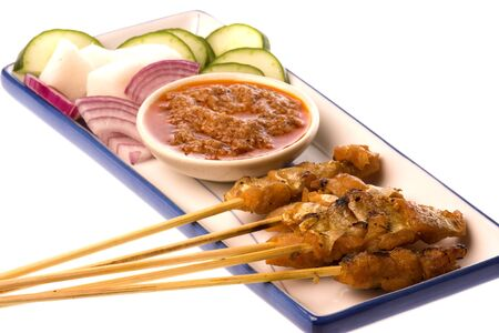 commonly: Image of a Malaysian delicacy commonly known as Fish Satay (bamboo stick skewered barbequed pieces of fish). Stock Photo