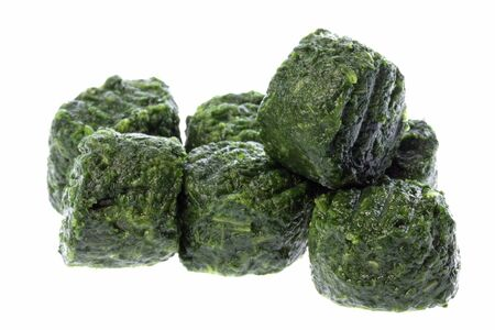 chopped: Isolated image of frozen chopped spinach. Stock Photo