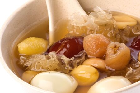 Isolated image of a a bowl of Chinese herbal sweet soup. Archivio Fotografico