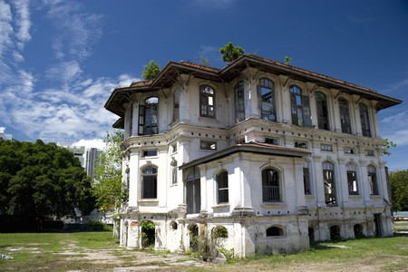 Image of a dilapidated heritage building located at UNESCOs World Heritage site of Georgetown, Penang, Malaysia. It used to be a proud home for one of Georgetowns richest man, subsequently a Chinese school and now unfortunately left to decay. photo