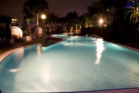 Night image of a swimming pool in Malaysia. Stock Photo