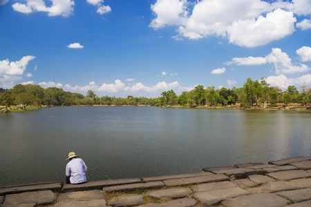 cambodia sculpture: Image of the moat at UNESCOs World Heritage Site of Angkor Wat, located at Siem Reap, Cambodia. Stock Photo