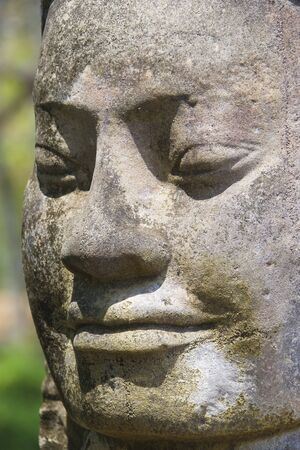 cambodia sculpture: Image of an ancient god statue at the South Gate of UNESCOs World Heritage Site of Angkor Thom, Siem Reap, Cambodia.