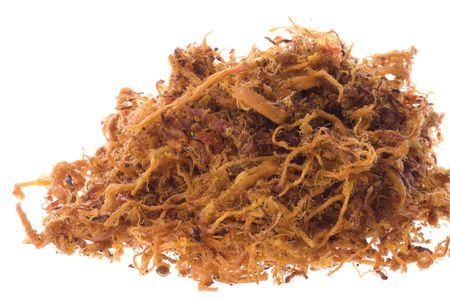 Isolated macro image of spicy chicken floss.