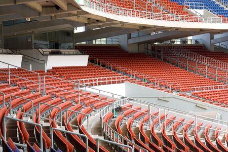 unoccupied: Image of colourful empty stadium seats.