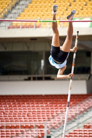 Image of a female pole vaulter in action. photo