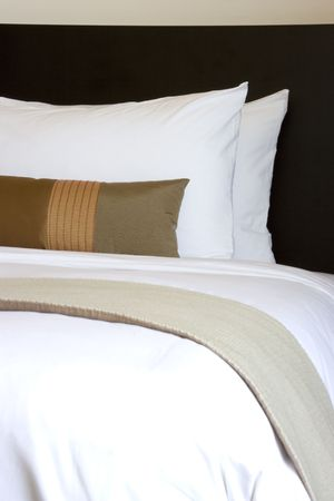 accomodation: Image of comfortable pillows and bed. Stock Photo