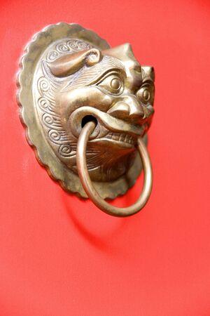 Image of an antique door knob on a bright red door. Stock Photo - 5471197
