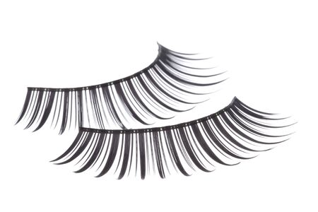 Isolated macro image of artificial eyelashes.