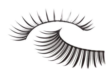 Isolated macro image of artificial eyelashes.