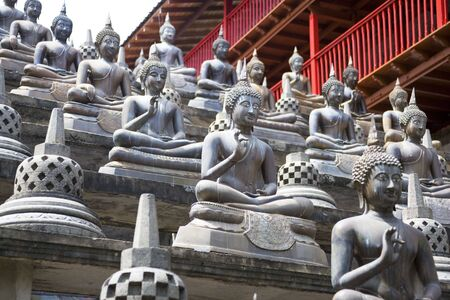 Image of Buddha statues at Gangaramaya Temple, Colombo, Sri Lanka.