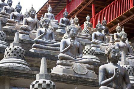 Image of Buddha statues at Gangaramaya Temple, Colombo, Sri Lanka.