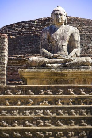 polonnaruwa: Image of a Buddha statue at the ancient Vatadage at Polonnaruwa, Sri Lanka. The Vatadage is a stupa house or relic shrine built around the 11th and 12th century AD. This is a UNESCO World Heritage site. Stock Photo