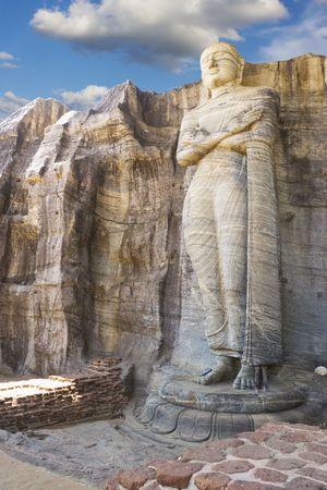 vihara: Image of a 7 meter high Buddha sculpture at Gal Vihara, Polonnaruwa, Sri Lanka. The colossal Buddha image, a masterpiece of Sri Lankan Buddhist art, was carved on the face of a granite boulder, commissioned by Parakramabahu I (1153-1186 AD). This is a UNE