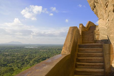 View from Sigiriya (Lion's Rock) taken at the steps beside the Mirror Wall. Originally this wall was so well polished that King Kassapa I (477-495 AD), who built the ancient rock fortress and palace, could see himself whilst he walked alongside it. This i Stock Photo - 5801637