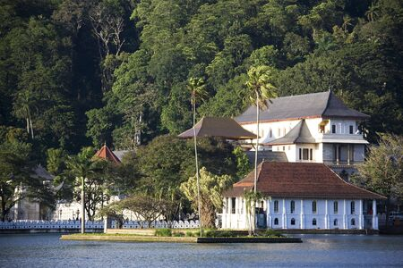 Image of the Temple of the Tooth and Royal Palace at Kandy, Sri Lanka.  The Temple of the Tooth is the worlds most sacred Buddhist site, where lies Buddhas tooth. Stock Photo