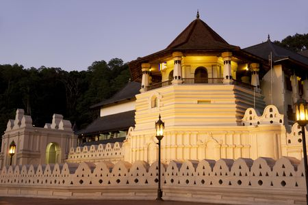 Night image of the Temple of Tooth at Kandy, Sri Lanka. This is a UNESCOs World Heritage site. The Temple of the Tooth is the worlds most sacred Buddhist site, where lies Buddhas tooth. photo