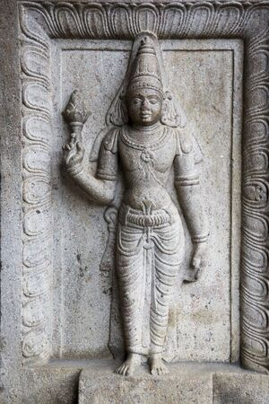 bass relief: Image of a stone guardian near the sacred at UNESCOs World Heritage site of the Temple of Tooth, Kandy, Sri Lanka.