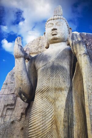 aukana buddha: Image of Aukana Budha, the tallest Buddha Statue in Sri Lanka. The rock cut statue which stands 39 feet above its decorated lotus plinth and 10 feet across the shoulders, belongs to the period of King Dhatusena (459-477 AD).