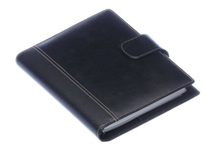 personal organizer: Isolated image of a black leather bound diary. Stock Photo
