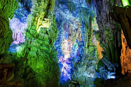 subterranean: Image of stalactite and stalagmite formations all lighted up at Reed Flute Cave, Guilin, Guangxi Zhuang Autonomous Region, China. Stock Photo