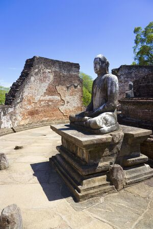 Image of a Buddha statue at the ancient Vatadage at Polonnaruwa, Sri Lanka. The Vatadage is a stupa house or relic shrine built around the 11th and 12th century AD. This is a UNESCO World Heritage site. photo