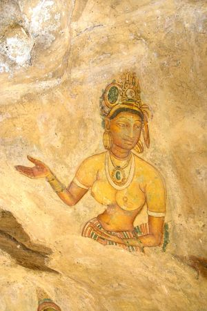 Image of an ancient fresco on the wall of Sigiriya (Lions Rock), Sri Lanka. This is a UNESCO World Heritage site. photo
