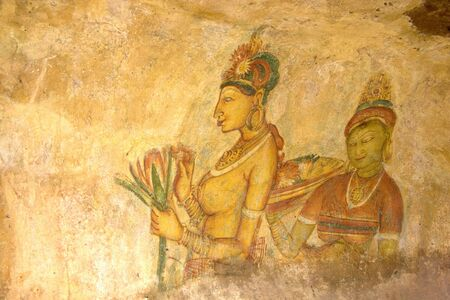 Image of ancient frescos on the wall of Sigiriya (Lions Rock), Sri Lanka. This is a UNESCO World Heritage site. photo