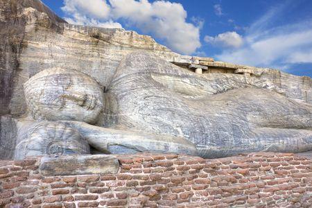 vihara: Image of a 14 meter reclining Buddha sculpture at Gal Vihara, Polonnaruwa, Sri Lanka.