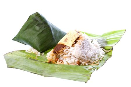 Isolated image of rice cooked in coconut milk and packed in banana leaf, commonly known as Nasi Lemak.  photo