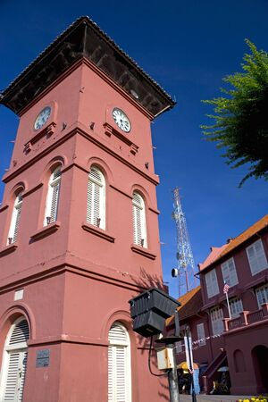 Dutch era clock tower built in the 18th century, located at the UNESCO World Heritage site of Malacca, Malaysia. Stock Photo
