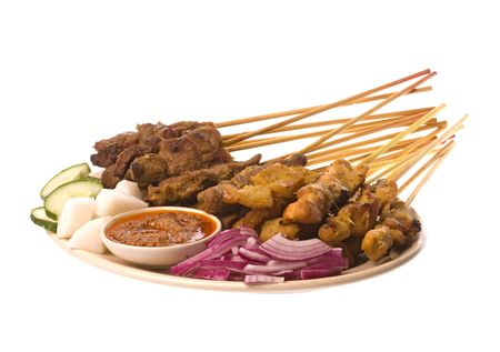 Image of a Malaysian delicacy commonly known as Satay (bamboo stick skewered barbequed meat). Imagens