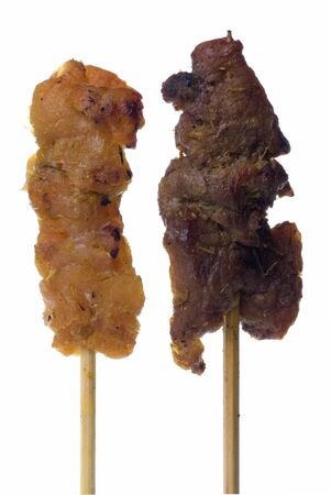 Macro image of a Malaysian delicacy commonly known as Satay (bamboo stick skewered barbequed meat) in isolation. photo