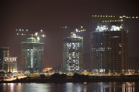 Night image of buildings under construction in Malaysia. Stock Photo - 5909375