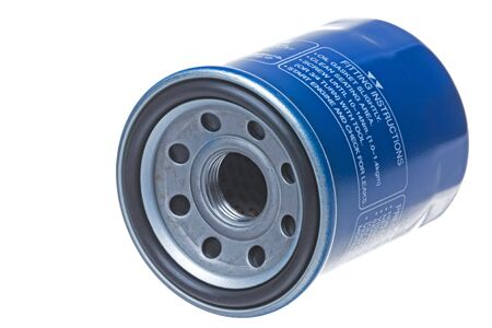 Isolated image of an engine oil filter.