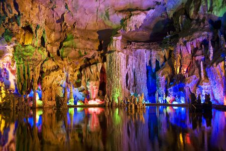 subterranean: Image of stalactite and stalagmite formations all lighted up at Assembly Dragon Cave, Yangshuo, Guilin, China. Stock Photo