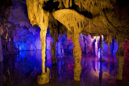 lighted: Image of stalactite and stalagmite formations all lighted up at Assembly Dragon Cave, Yangshuo, Guilin, China. Stock Photo