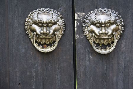 Image of old door knobs on a temple door at Guilin, China. Stock Photo - 5909599