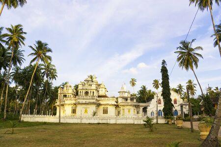 Image of the ancient Nayake Buddhist Temple and Dutch era Christian Church side by side, at Balapitiya, Sri Lanka. photo