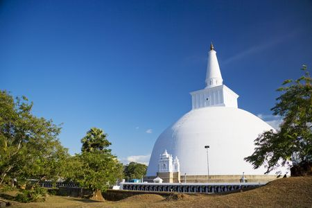 supposed: Image of UNESCOs World Heritage Site of Ruvanveli Dagoba, located at Anuradhapura, Sri Lanka. Ruvanveli Dagoba is the pride of the Great Emperor Dutugamunu. Raised in the 2nd century B.C. this dagoba is supposed to have the perfect water bubble shape. Stock Photo